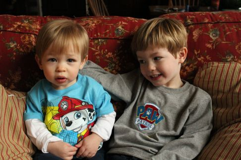Brothers modeling their party Paw Patrol attire
