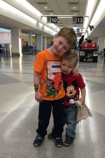 Early morning flight, two very excited boys