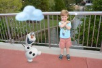Lucas' favorite magic shot, looking cold with Olaf